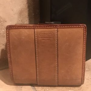 Tan Coach Medium Wallet in good shape.